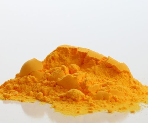 A pile of cheddar cheese seasoning from DFA Ingredient Solutions.
